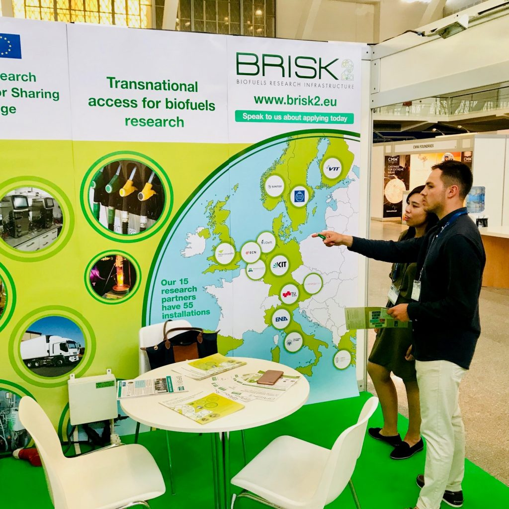 Aston University PhD students Joseph Socci and Regina Siu at the BRISK2 stand at EUBCE 2019, Lisbon